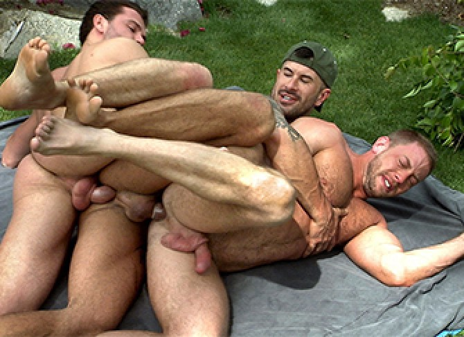Men having group sex